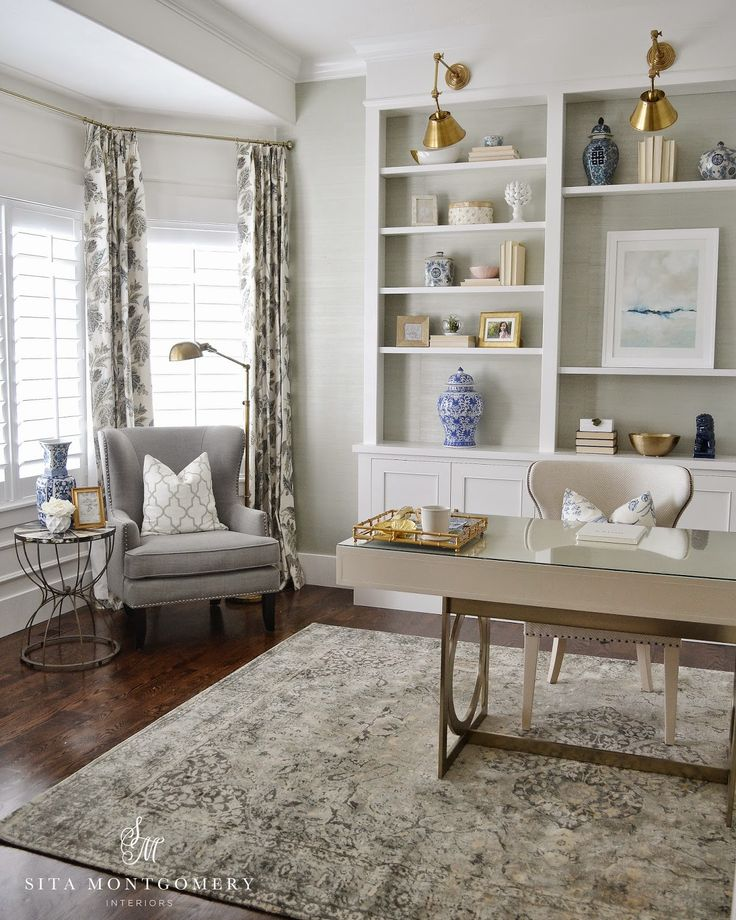 stylish home office with built-ins with wallpaper and gold accents