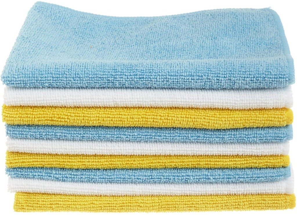 Closeup of blue yellow and white microfiber cleaning cloths