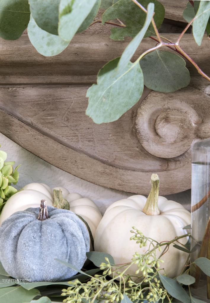 Closeup of mini pumpkins and eucalyptus and french mansard mirror