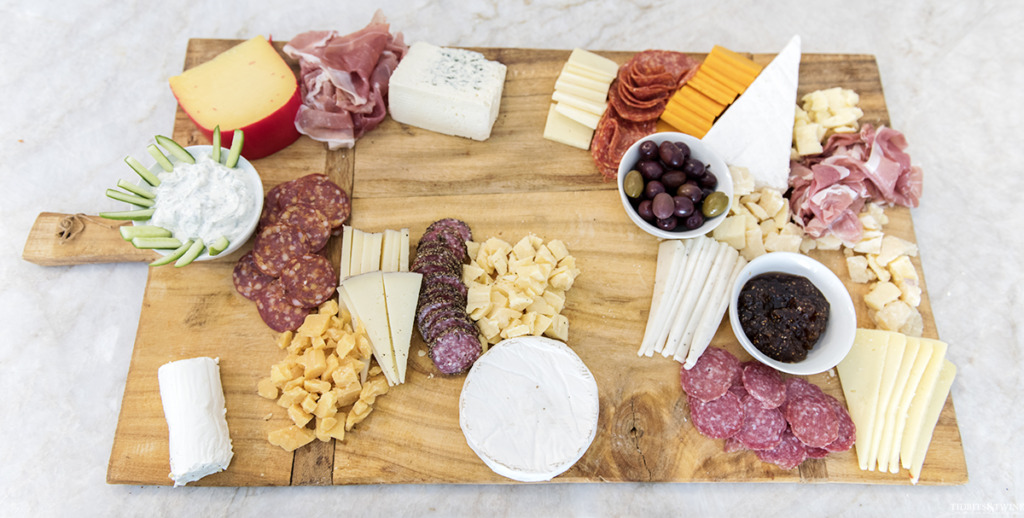 DIY charcuterie board with dips meats and cheeses