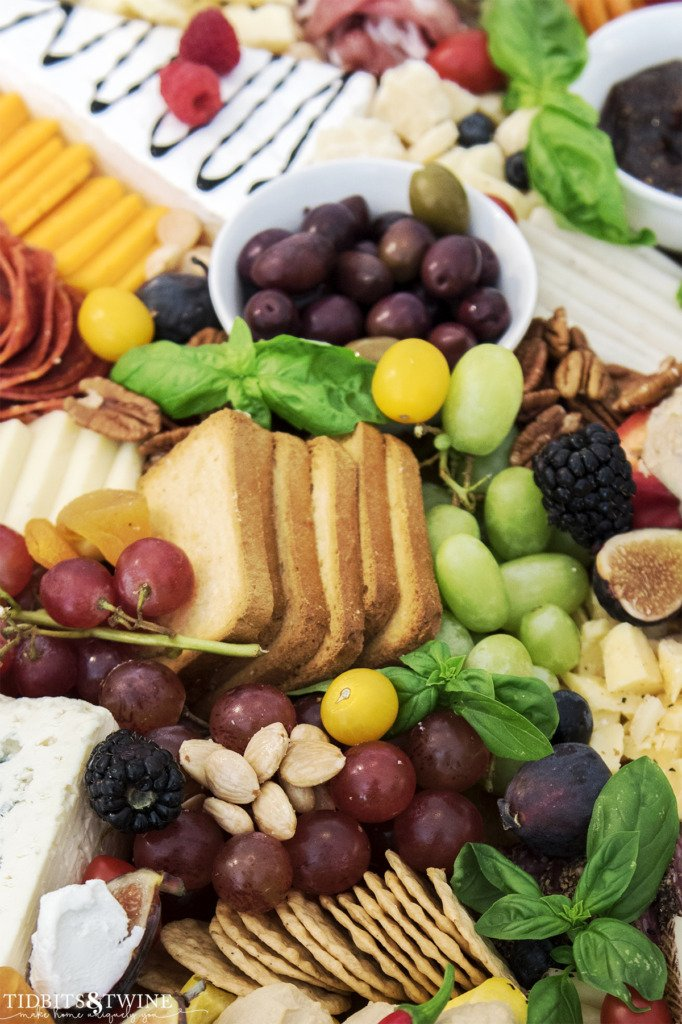 Closeup of meat and cheese charcuterie board showing grapes and marcona almonds