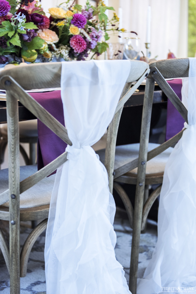 white ruffle chair sashes on crossback chairs in fall french dining room