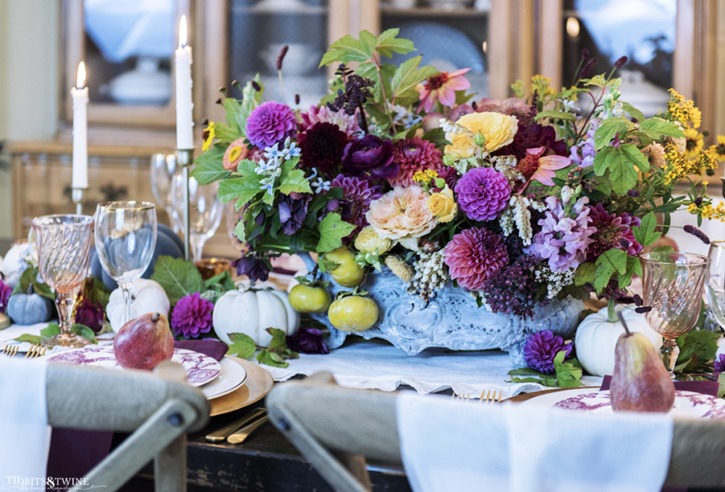 oversized french flower centerpiece on fall table with candles and pumpkins