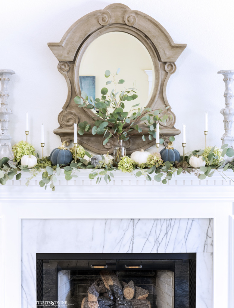 French living room mantel decorated for Fall with eucalyptus candles and little pumpkins