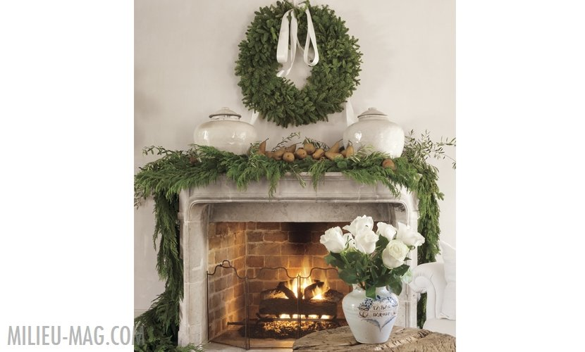 French stone mantel with cedar garland and pears with wreath over mantel