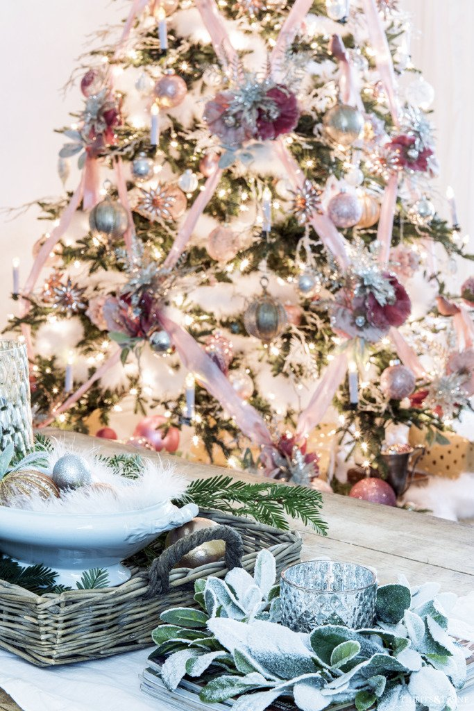 Pink Christmas tree with criss cross ribbons and pink and white coffee table decor