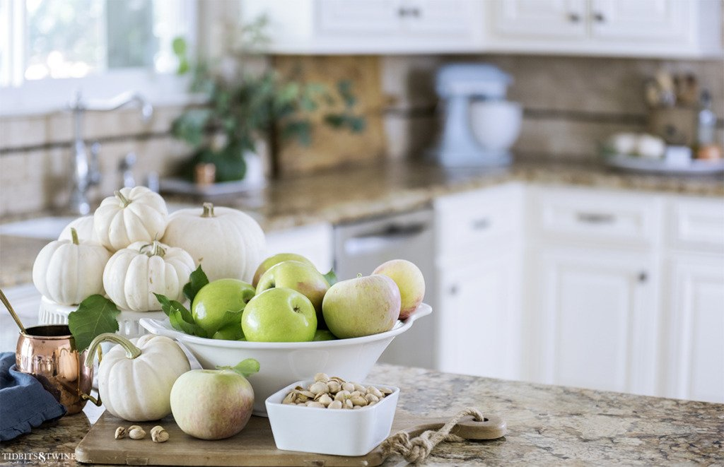 French kitchen decorated for Fall with white pumpkins and eucalyptus