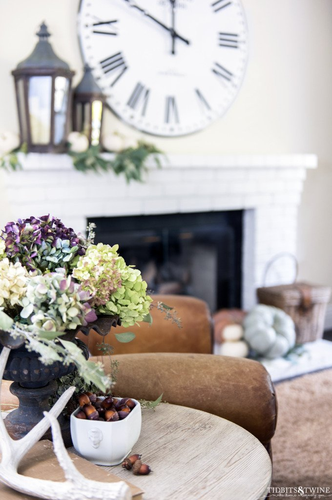 Side table with dried hydrangeas acorns and antler in fall family room