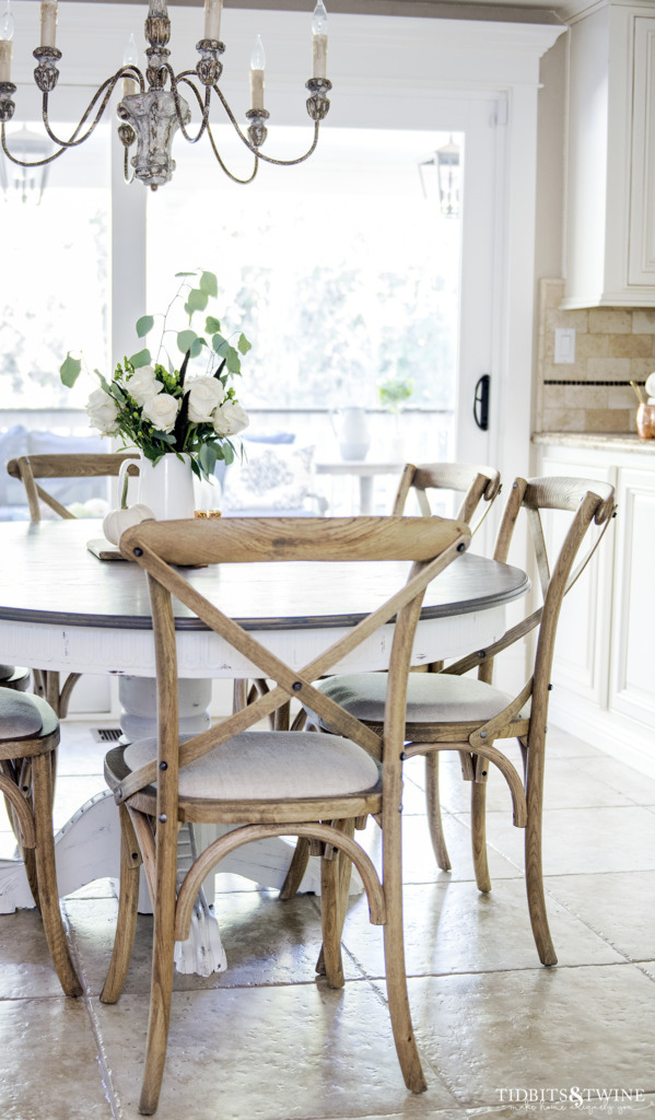 French farmhouse kitchen table and chairs with French chandelier