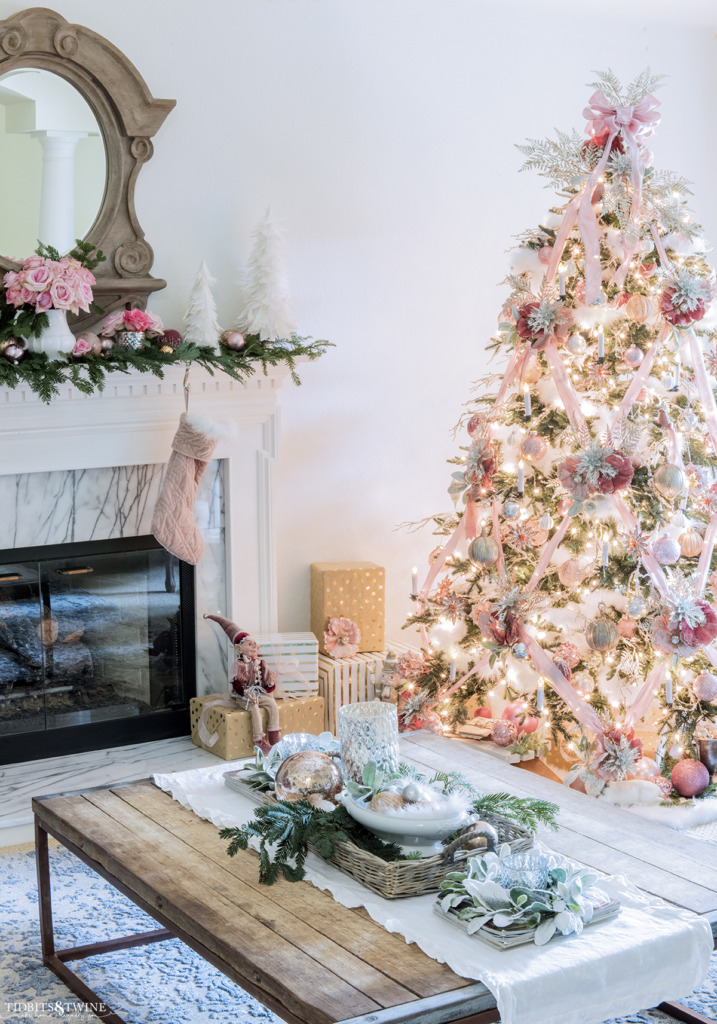 French living room with fireplace decorated for Christmas with pink and white tree