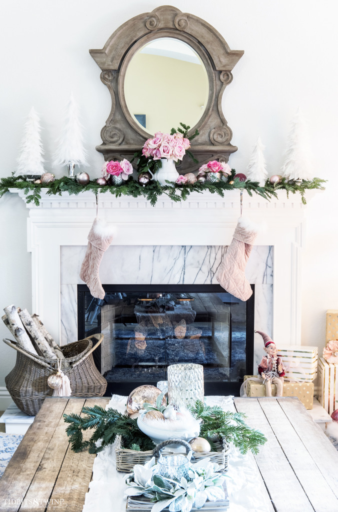 Living room Christmas fireplace mantel with French mansard mirror above in pink and white