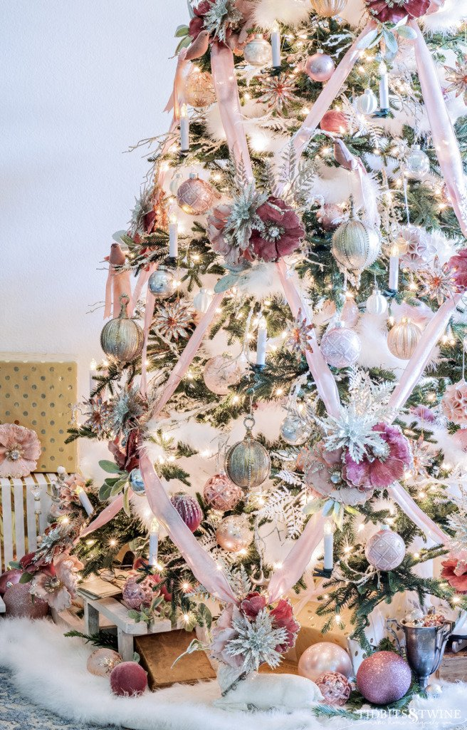 Christmas tree decorated in pink gold silver and white with crisscross ribbon