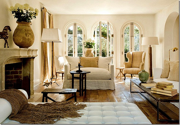 European style neutral living room with wood floors and linen furnishings