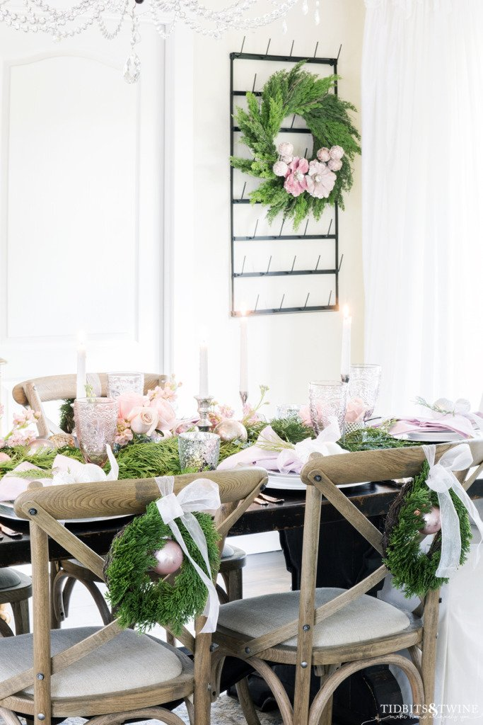 Pink green and silver Christmas tablescape idea in dining room