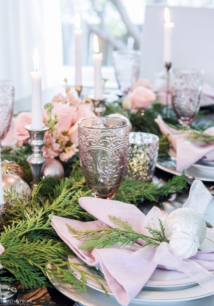 Christmas place setting with pink and silver and white and garland