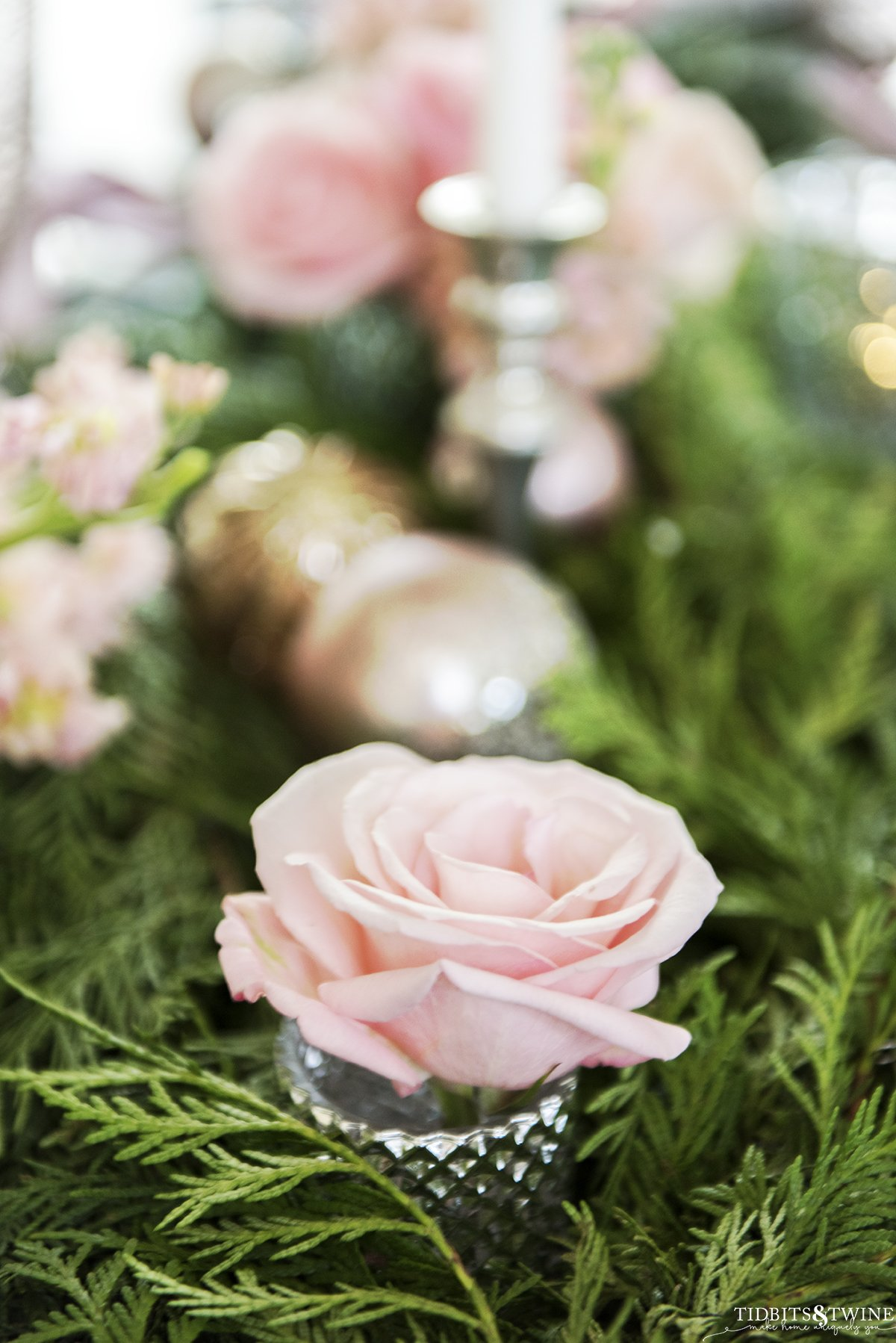 Pink Christmas table with cedar garland pink roses pink ornaments and white candles
