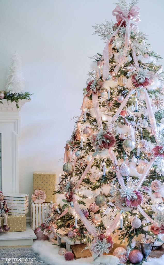 French living room with a Christmas tree decorated with pink silver gold and white