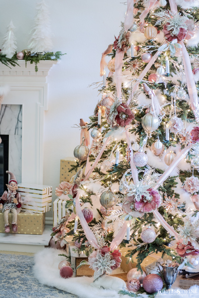 Vintage pink Christmas tree with velvet ribbon and flowers