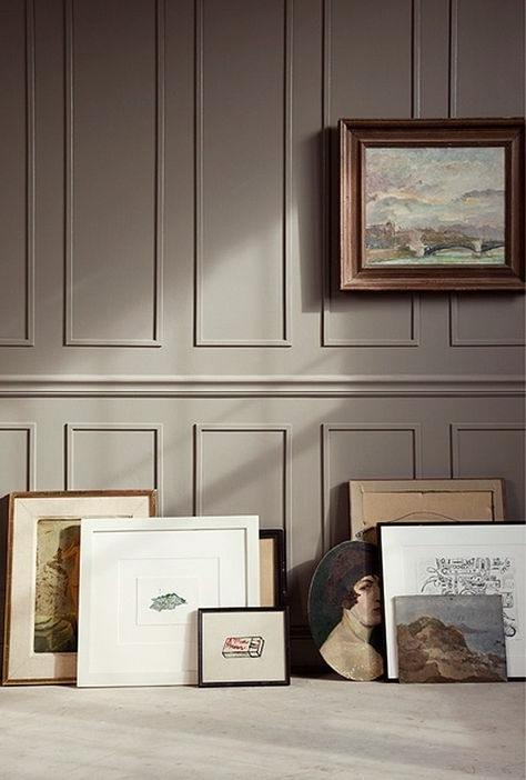 Benjamin Moore Kingsport Gray painted wall with picture frames laying on the ground