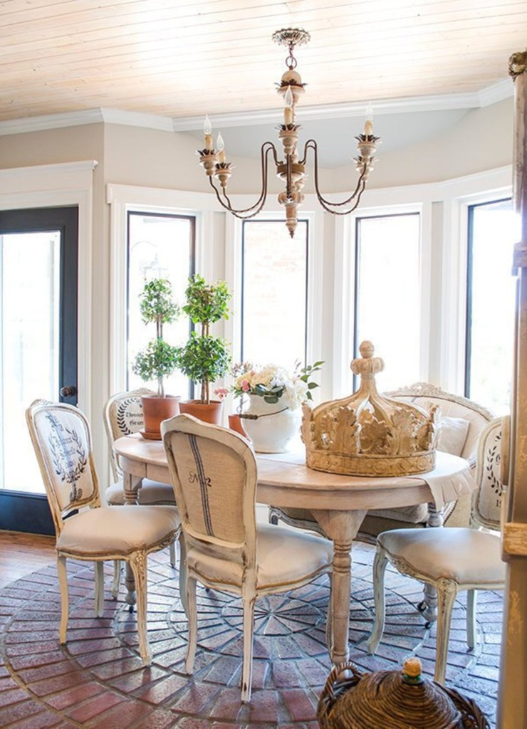 Edith and Evelyn French dining room with wooden crown grainsack chairs and topiaries