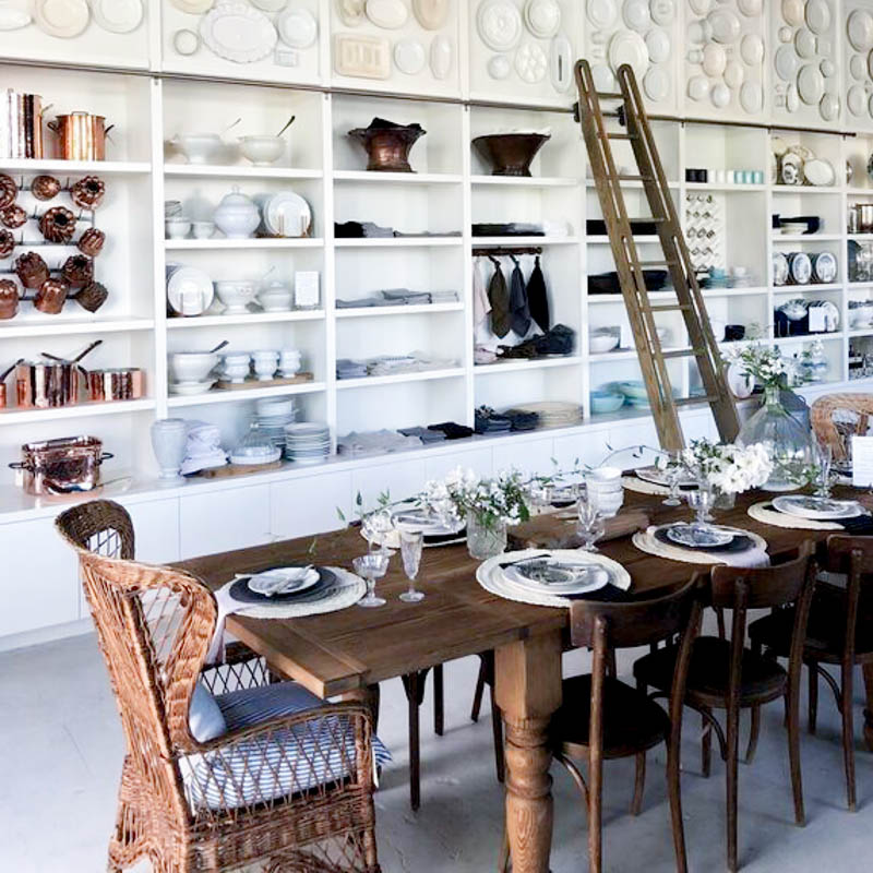 Elsie Green store with European antique ironstone ladders and table settings