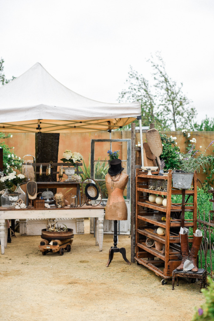 Chateau Sonoma sales event with vintage dress form bread paddles and gorgeous French antiques