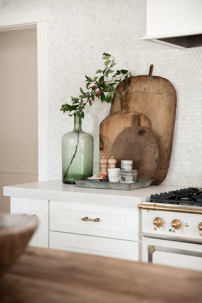 Boxwood Lane white kitchen with vintage bread board display on counter