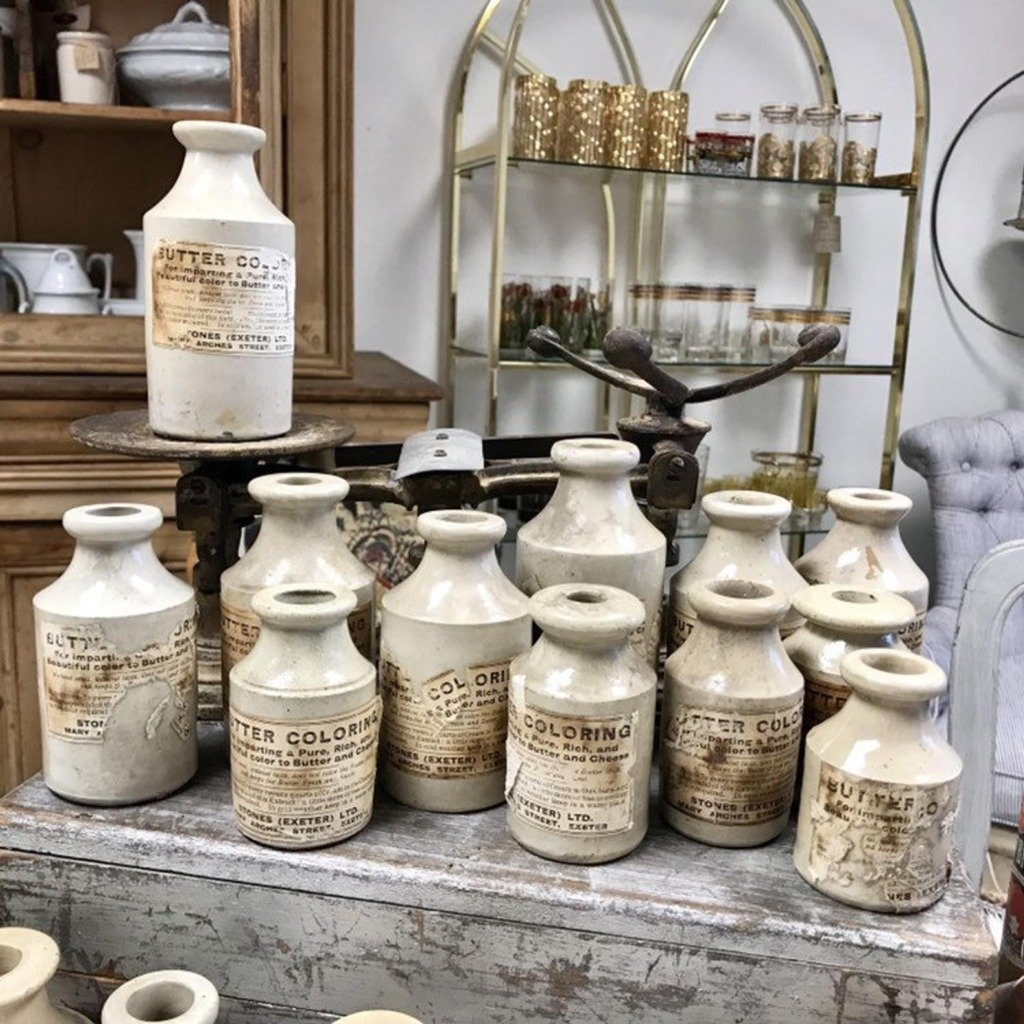 Lavender Road Antiques display with French antique bottles and scale