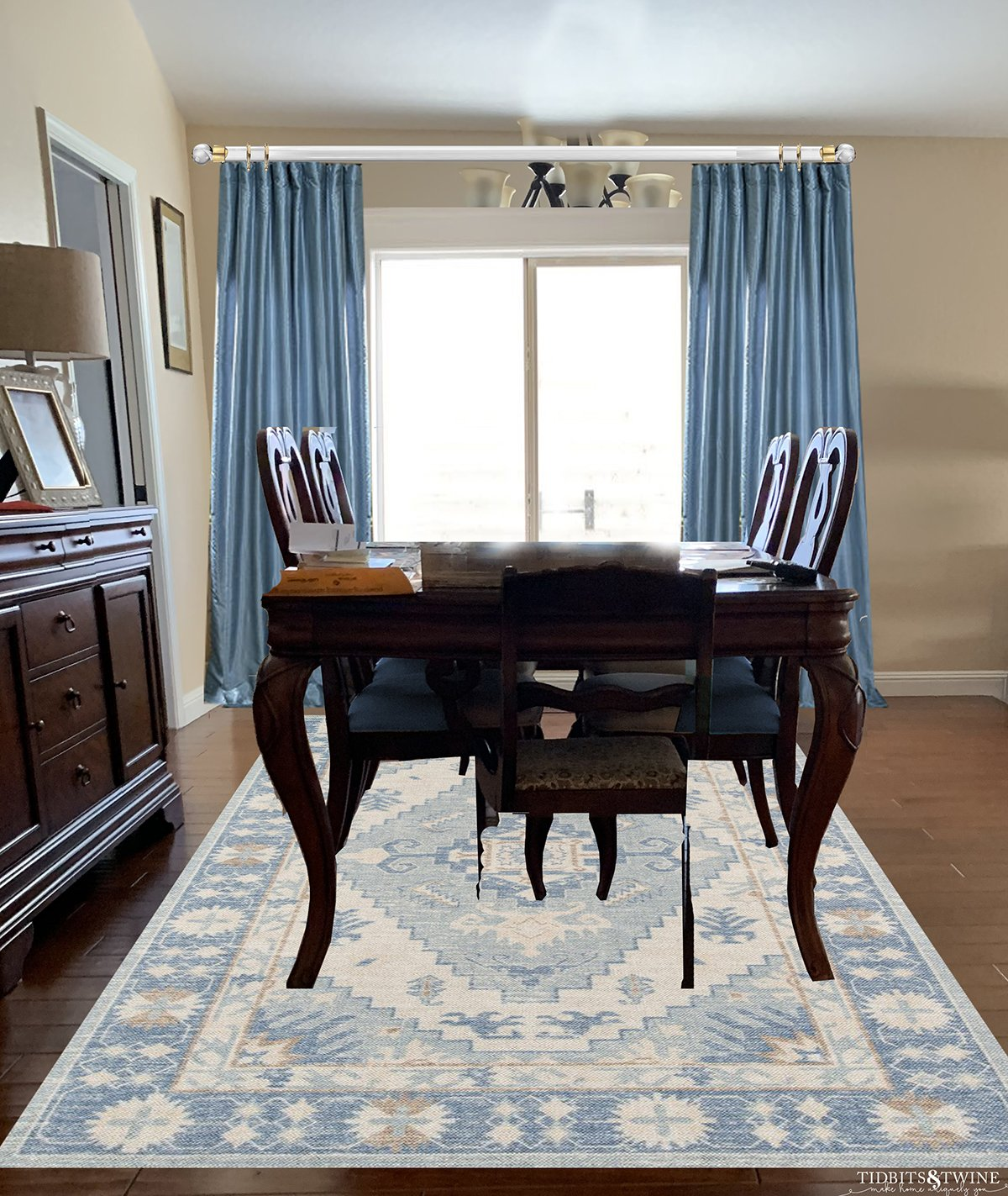 Traditional dining room dark queen anne dining table with blue silk curtains and blue contemporary rug