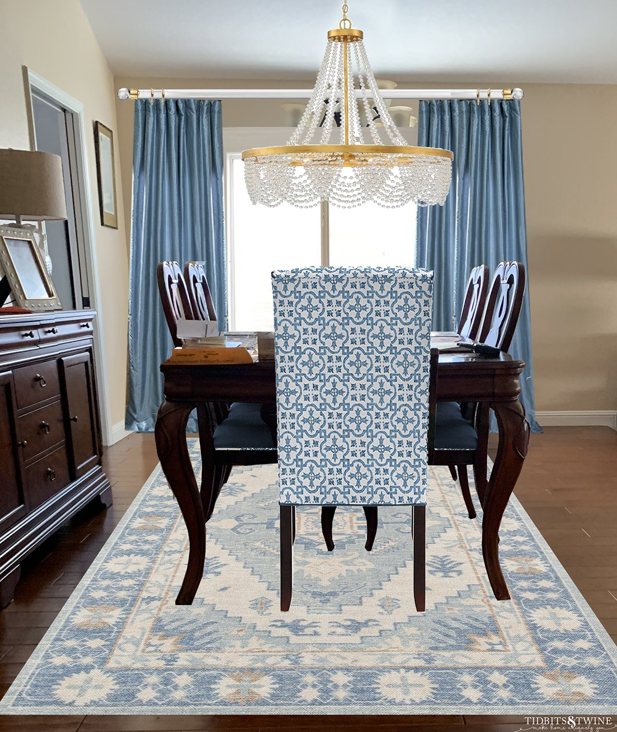 Traditional and contemporary dining room traditional table blue silk curtains blue contemporary rug and chair and chandelier