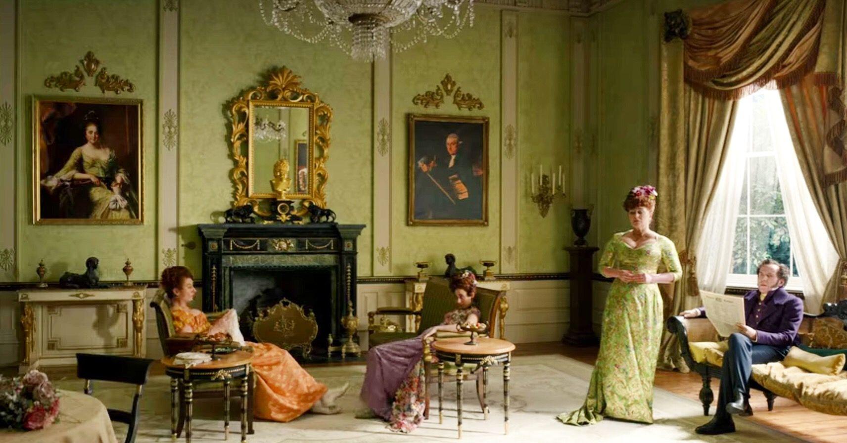 Netflix Bridgertin Featherington drawing room with green walls and Regency settees