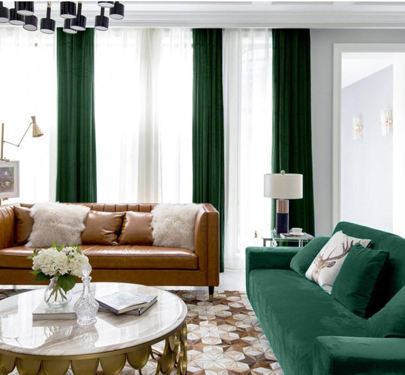 contemporary living room with green velvet curtains and sofa and geometric rug