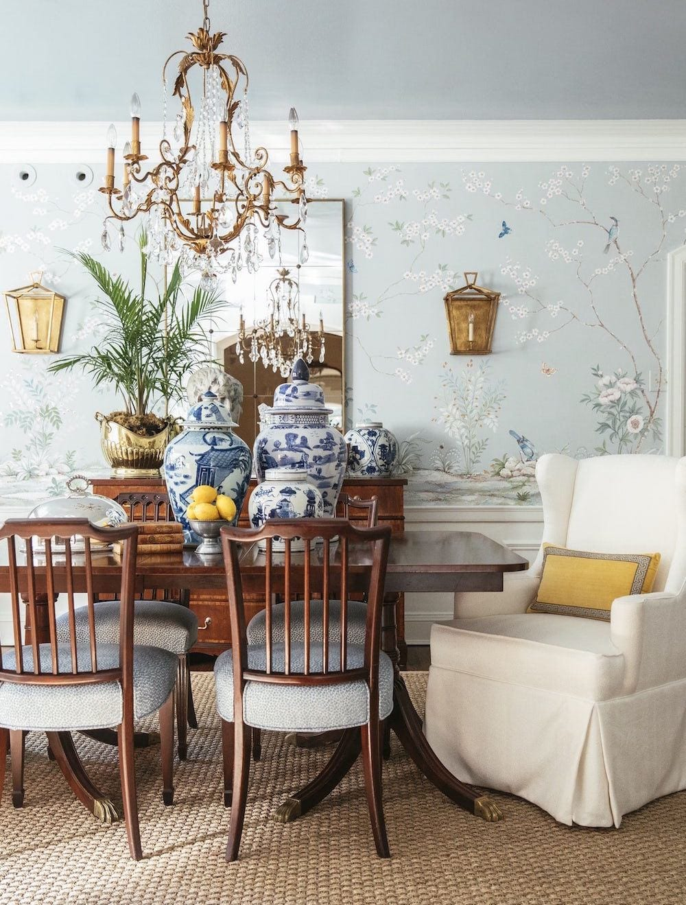 Regency style dining room with light blue chinoiserie wallpaper and gold accents
