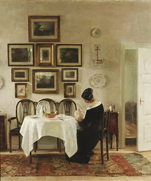 Carl Holsoe art of woman sitting at dining table with baby and wall of artwork