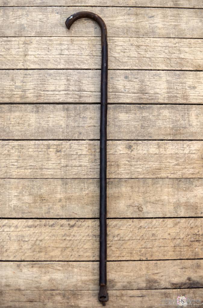 wooden antique cap gun gadget cane laying on wooden pallet