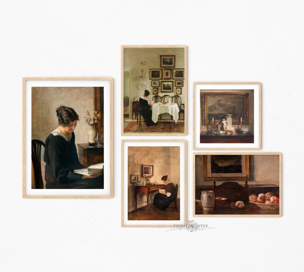 Five Carl Holsoe painted framed on a wall