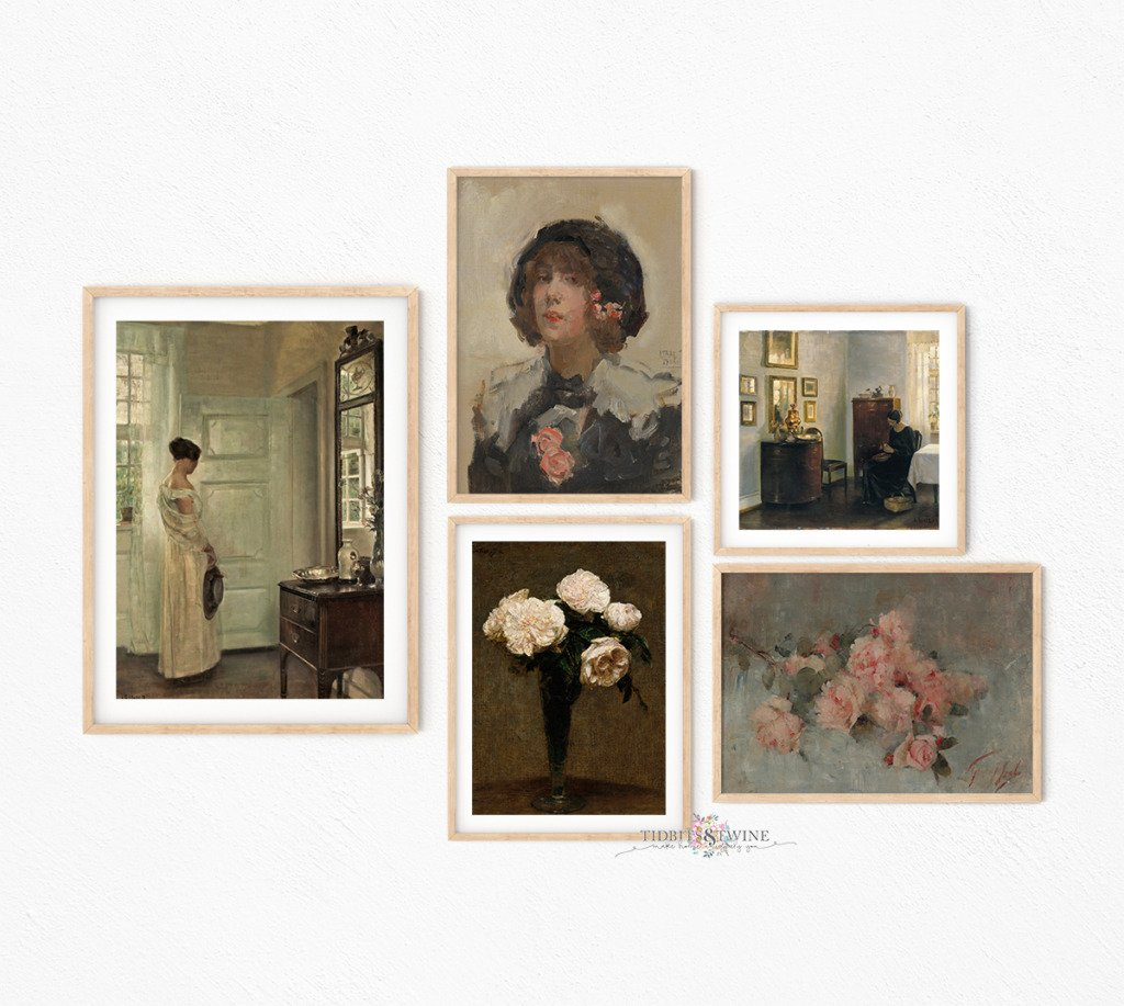 A gallery wall of framed Carl Holsoe art and flower art on a white wall