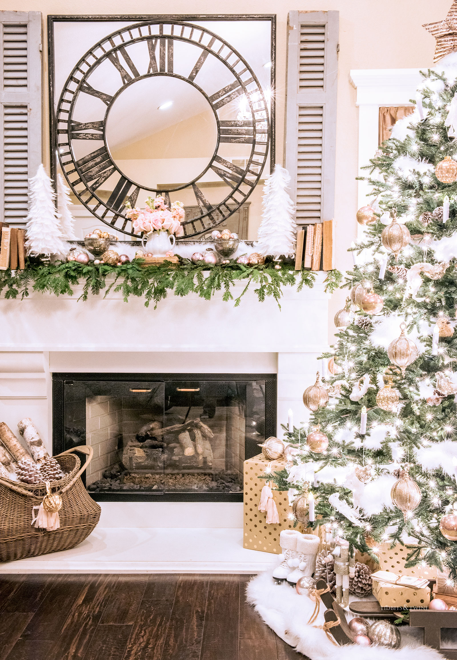 Bedroom mantel decorated for Christmas in pink gold and white with a Christmas tree nearby