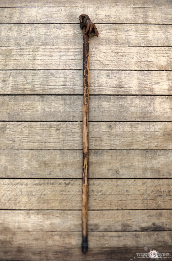 rustic wooden antique gadget cane measuring tape and compass