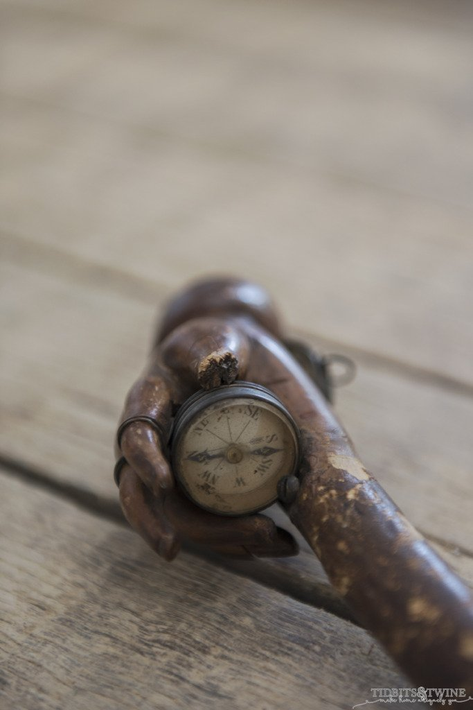 wooden hand cane handle that holds an antique compass