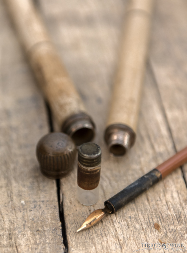 antique gadget cane that unscrews to reveal a glass bottle for ink and a fountain pen