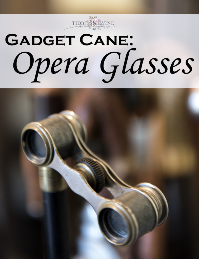 closeup of opera glasses gadget cane aged brass
