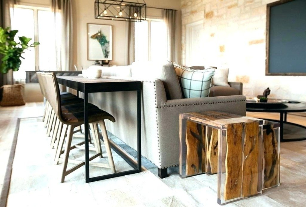 narrow dining bar table behind a sofa in an industrial living room