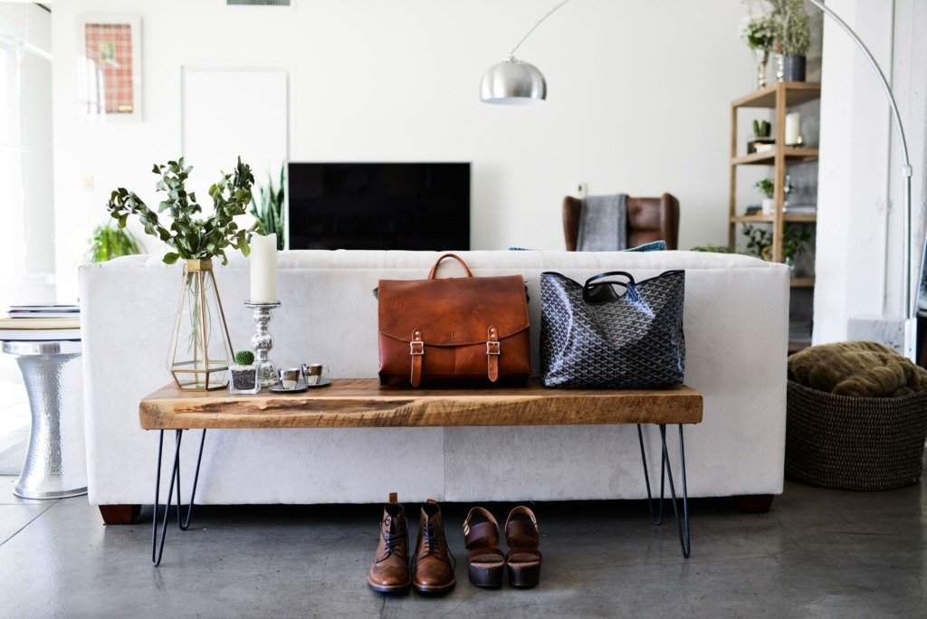 wood bench with hairpin legs behind a sofa in modern living room