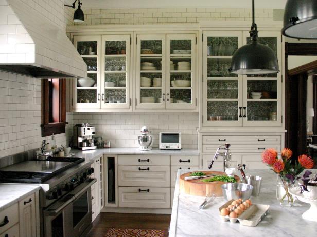 kitchen with white cabinets and black hardware subway tile backsplash
