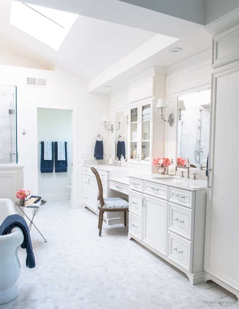 french bathroom with marble floor and white double vanity