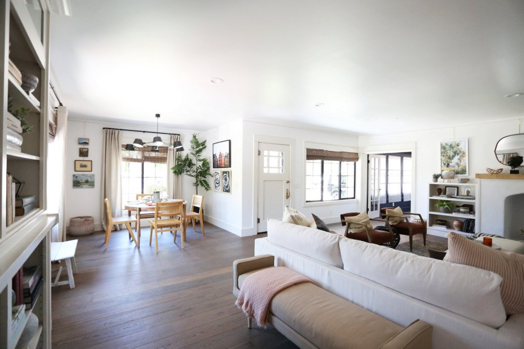 open floorplan with upholstered bench behind sofa
