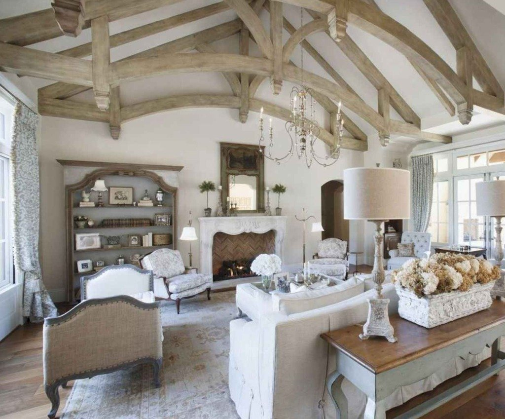 french living room with vaulted ceiling with beams