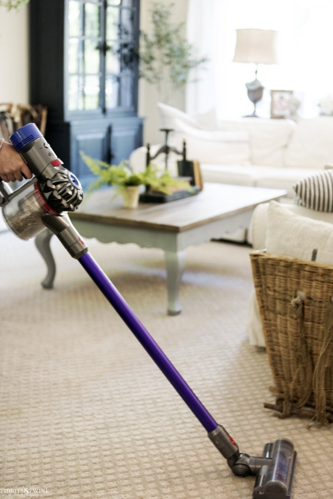 dyson cordless vacuum in french family room