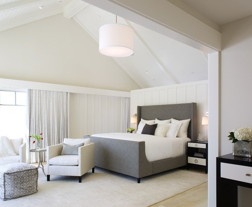 bedroom painted natural choice with dark gray upholstered bed with white linens and seating area at foot of bed